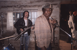 "Dave Stewart, R.L. Burnisde and Jessie Mae Hemphill at Junior Kimbrough's juke joint during the filming of Robert Mugge's ""Deep Blues"""